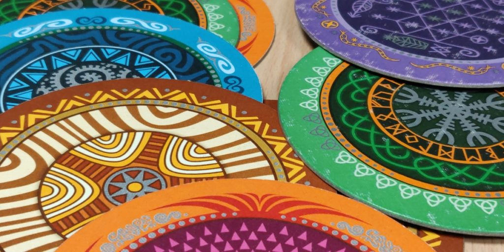A set of round cards with rich patterns, each in a specific color shade.